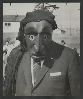 [Lt. Gov. George Pearkes wearing tribal mask]