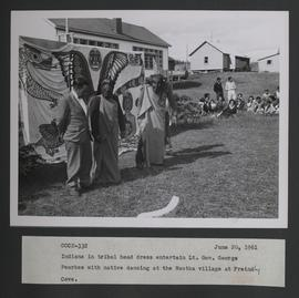 Indians in tribal head dress entertain Lt. Gov. George Pearkes with native dancing at the Nootka ...